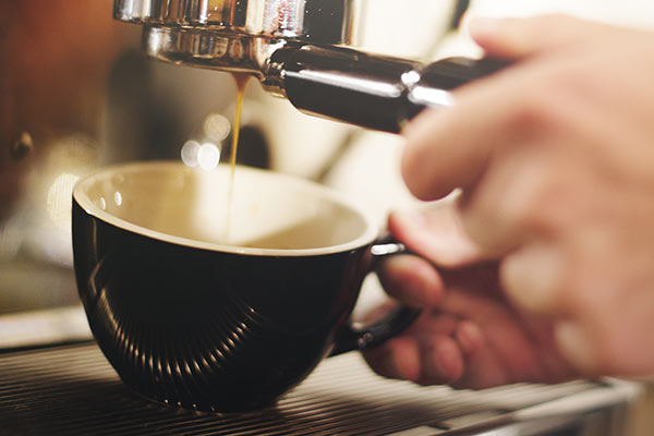 a photo of a fresh cup of coffee being prepared